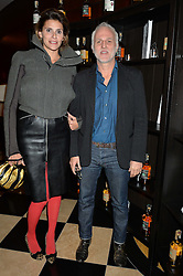 MOURAD MAZOUZ and CAROLINE KARIM KASSAR at the London launch of Casamigos Tequila hosted by Rande Gerber, George Clooney & Michael Meldman and to celebrate Cindy Crawford's new book 'Becoming' held at The Beaumont Hotel, Brown Hart Gardens, 8 Balderton Street, London on 1st October 2015.