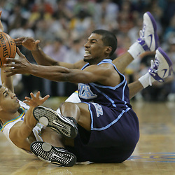 Utah Jazz guard Ronnie Price #17 fights for a loose ball with New Orleans Hornets guard Jannero Pargo #2 in the second quarter of their NBA game on April 8, 2008 at the New Orleans Arena in New Orleans, Louisiana.