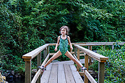 Girl posing confidently on a footbridge.
