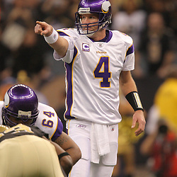 Jan 24, 2010; New Orleans, LA, USA; Minnesota Vikings quarterback Brett Favre (4) under center during a 31-28 overtime victory by the New Orleans Saints over the Minnesota Vikings in the 2010 NFC Championship game at the Louisiana Superdome. Mandatory Credit: Derick E. Hingle-US PRESSWIRE.
