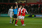 Referee Marc Edwards shows a yellow card to Ched Evans of Fleetwood Town   during the The FA Cup match between Fleetwood Town and Portsmouth at the Highbury Stadium, Fleetwood, England on 4 January 2020.