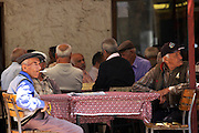 Local men sitting outside a cafe in Turkey.