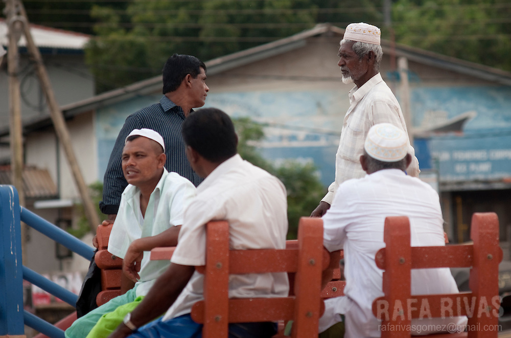 Muslim men chat at the Hanbantota sea-port, in Sri Lanka, on February, 26, 2011.