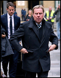 Tottenham Hotspur manager Harry Redknapp, 64, arrives at Southwark Crown court on January 25, 2012, London. Mr Redknapp is faces charges of Tax Evasion dating back to between 2002 and 2004, when he was the Portmouth's manager. According to reports payments were made to Mr Redknapp's Monaco bank account in the name of his dog Rosie. His son Jamie is in the background Photo By i-images