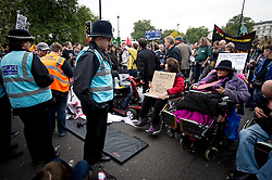 © London News Pictures. 20/10/2012. London, UK. A group of demonstrators in wheelchairs block Park Lane in London during a mass rally organised by the TUC (Trades Union Congress) on October 20, 2012 to protest against the government's austerity policies and call for an alternative economic strategy. The march is followed by a rally in Hyde Park in which Labour Party Leader Ed Miliband will speak. Photo credit : Ben Cawthra /LNP