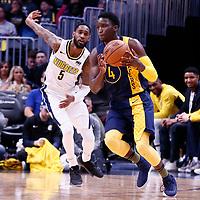 03 April 2018: Indiana Pacers guard Victor Oladipo (4) drives past Denver Nuggets forward Will Barton (5) during the Denver Nuggets 107-104 victory over the Indiana Pacers, at the Pepsi Center, Denver, Colorado, USA.