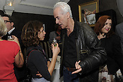 ISABEAU DOUCET; NICK DAVIES; WINNER OF THE MAVERICK AWARD, The 2011 Groucho Club Maverick Award. The Groucho Club. Soho, London. 14 November 2011. <br /> <br />  , -DO NOT ARCHIVE-© Copyright Photograph by Dafydd Jones. 248 Clapham Rd. London SW9 0PZ. Tel 0207 820 0771. www.dafjones.com.