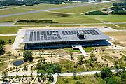 Nederland, Utrecht, Gemeente Soest, 30-09-2015. Nationaal Militair Museum op de voormalige vliegbasis Soesterberg. Het NMM is ontworpen door Claus en Kaan Architecten in samenwerking met Kossmann.dejong en H+N+S en wordt beheerd door Heijmans PPP (public–private partnership).<br /> National Military Museum at the former Soesterberg airbase.<br /> <br /> luchtfoto (toeslag op standard tarieven);<br /> aerial photo (additional fee required);<br /> copyright foto/photo Siebe Swart