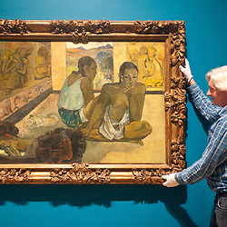 London, UK - 19 June 2013: Graeme Barraclough, Chief Conservator at Courtauld Gallery works on a canvas by Paul Gauguin entitled ?Te Rerioa (The Dream) 1897?