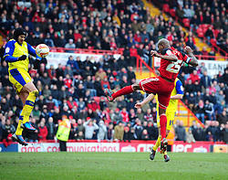 Sheffield Wednesday's Miguel Angel Llera appears to block Bristol City's Marvin Elliott's header towards goal with his arm - Photo mandatory by-line: Joe Meredith/JMP - Tel: Mobile: 07966 386802 01/04/2013 - SPORT - FOOTBALL - Ashton Gate - Bristol -  Bristol City V Sheffield Wednesday - Npower Championship