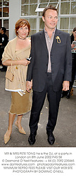 MR & MRS PETE TONG he is the DJ, at a party in London on 8th June 2002.<br />
