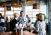 A server at Bartaco restaurant takes drink orders from guests at Hilldale Shopping Center in Madison, WI on Thursday, April 18, 2019.