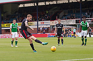 27th August 2017, Dens Park, Dundee, Dundee; Scottish Premier League football, Dundee versus Hibernian; Dundee's Kevin Holt scores to put his team 1-0 ahead from the penalty spot