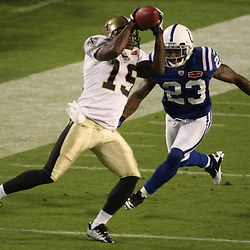 2010 February 07: New Orleans Saints wide receiver Devery Henderson (19) catches a pass in front of Indianapolis Colts safety Tim Jennings (23) during a 31-17 win by the New Orleans Saints over the Indianapolis Colts in Super Bowl XLIV at Sun Life Stadium in Miami Gardens, Florida.