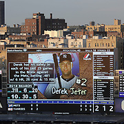 Derek Jeter on the big screen at Yankee Stadium with the early evening light catching the buildings outside the stadium during the New York Yankees V New York Mets Subway Series Baseball game at Yankee Stadium, The Bronx, New York. 8th June 2012. Photo Tim Clayton
