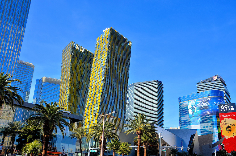 Veer Towers in CityCenter in Las Vegas, Nevada<br /> These twin yellow towers in the heart of CityCenter lean five degrees towards each other and are appropriately called Veer Towers.  Together the 480 foot high-rises contain nearly 675 condominiums.  Studio condos start at about $280,000.