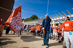 "Former Virginia tight end Heath Miller raises the ""Power of Orange"" flag before the start of the ECU game.  The Virginia Cavaliers defeated the East Carolina Pirates 35-20 in NCAA football at Scott Stadium on the Grounds of the University of Virginia in Charlottesville, VA on October 11, 2008."