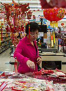 A woman looks at the Chinese New Year items at Arcadia Market on Saturday, Feburay 2, 2013 ahead of the Lunar New Year in Los Angeles, California,  This year, the first day of the Year of the Snake, falls on Sunday, Feburary10.  (Photo by Ringo Chiu/PHOTOFORMULA.com).