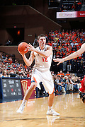 CHARLOTTESVILLE, VA - DECEMBER 4: Joe Harris #12 of the Virginia Cavaliers handles the ball against the Wisconsin Badgers during the Big Ten/ACC Challenge game at John Paul Jones Arena on December 4, 2013 in Charlottesville, Virginia. Wisconsin won 48-38. (Photo by Joe Robbins) *** Local Caption *** Joe Harris