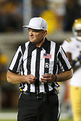 BERKELEY, CA - OCTOBER 06: NCAA referee Terry Leyden during the fourth quarter between the California Golden Bears and the UCLA Bruins at California Memorial Stadium on October 6, 2012 in Berkeley, California. The California Golden Bears defeated the UCLA Bruins 43-17. (Photo by Jason O. Watson/Getty Images) *** Local Caption *** Terry Leyden