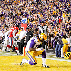 November 17, 2012; Baton Rouge, LA, USA;  LSU Tigers running back Spencer Ware (11) celebrates after scoring on a two-point conversion to tie the game in the fourth quarter against the Ole Miss Rebels in a game at Tiger Stadium. LSU defeated Ole Miss 41-35. Mandatory Credit: Derick E. Hingle-US PRESSWIRE