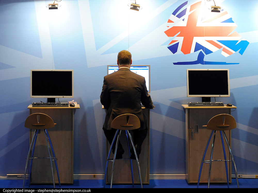 © Licensed to London News Pictures. 05/10/2011. MANCHESTER. UK. A man uses a computer at The Conservative Party Conference at Manchester Central today, October 5, 2011. Photo credit:  Stephen Simpson/LNP