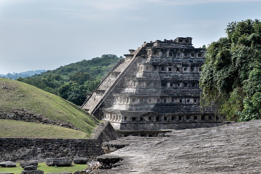Mesoamerica Pyramid of the Niches at the pre-Columbian archeological complex of El Tajin in Tajin, Veracruz, Mexico. El Tajín flourished from 600 to 1200 CE and during this time numerous temples, palaces, ballcourts, and pyramids were built by the Totonac people and is one of the largest and most important cities of the Classic era of Mesoamerica.