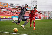Bruno Andrade of Lincoln City under pressure from Kyle Knoyle of Swindon Town during the EFL Sky Bet League 2 match between Swindon Town and Lincoln City at the County Ground, Swindon, England on 12 January 2019.