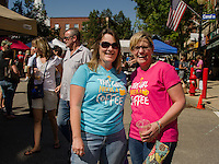 """Kim Williams from Lunenburg, VT and Deborah Weeks from Groveton, NH came to right place for """"their cup of coffee"""" during Saturday's Coffee Festival in downtown Laconia.  (Karen Bobotas/for the Laconia Daily Sun)"""