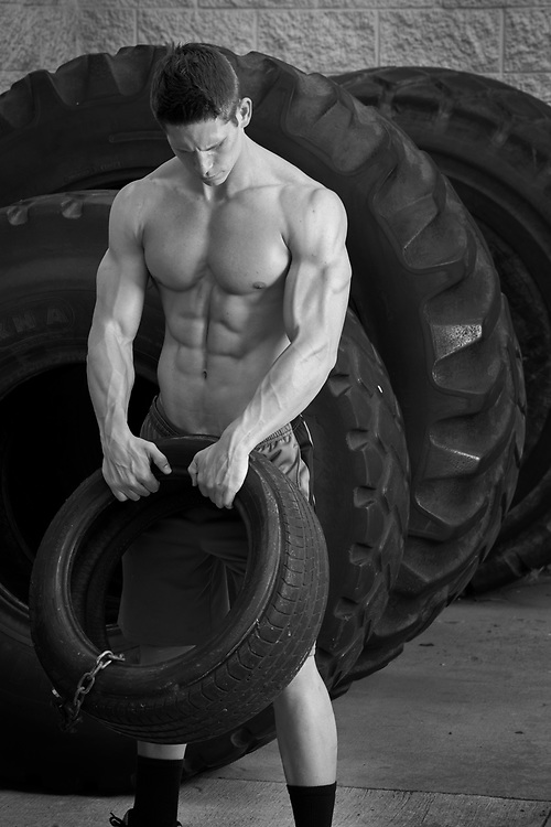 Body Builder lifting tires at Armbrust Gym in Westminister, CO