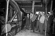 5/06/1963.06/15/1963.15 June 1963.Finnish visitors tour Bord na Mona works..the 48 members of the Finnish Peat Society, who arrived in dublin on Friday 14/06/1963, toured Bord na Mona works in Offaly and Kildare on Saturday..The Finnish visitors, led by Mr. V. Puustjarvi, (left) University of Helsinki, discussing the briquette process with Croghan factory manager Mr P. McEvilly (2nd from left) at Croghan briquette factory near Mount Lucas, Co. Offaly. ..