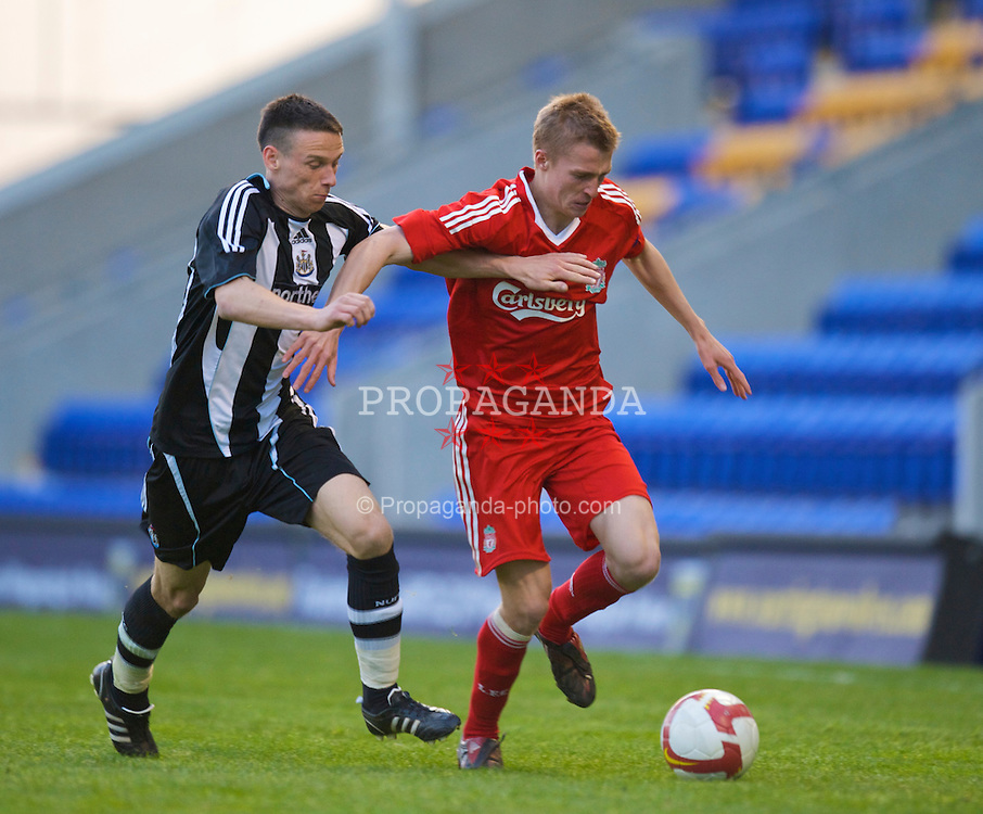WARRINGTON, ENGLAND - Wednesday, April 29, 2009: Liverpool's Stephen Darby and Newcastle United's Philip Airey during the FA Premiership Reserves League (Northern Division) match at the Halliwell Jones Stadium. (Photo by David Rawcliffe/Propaganda)