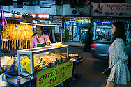 Thai woman prepares kebabs from a cart, Pattaya, Thailand, Southeast Asia
