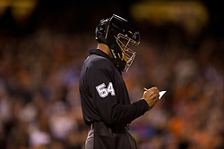 SAN FRANCISCO, CA - APRIL 16:  MLB umpire CB Bucknor #54 marks changes to his line up card during the ninth inning between the San Francisco Giants and the Arizona Diamondbacks at AT&T Park on April 16, 2015 in San Francisco, California.  The Arizona Diamondbacks defeated the San Francisco Giants 7-6 in 12 innings. (Photo by Jason O. Watson/Getty Images) *** Local Caption *** CB Bucknor
