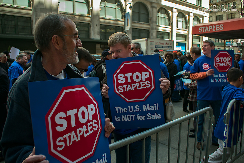 Postal workers picketing outside a Staples store, New York, NY, US
