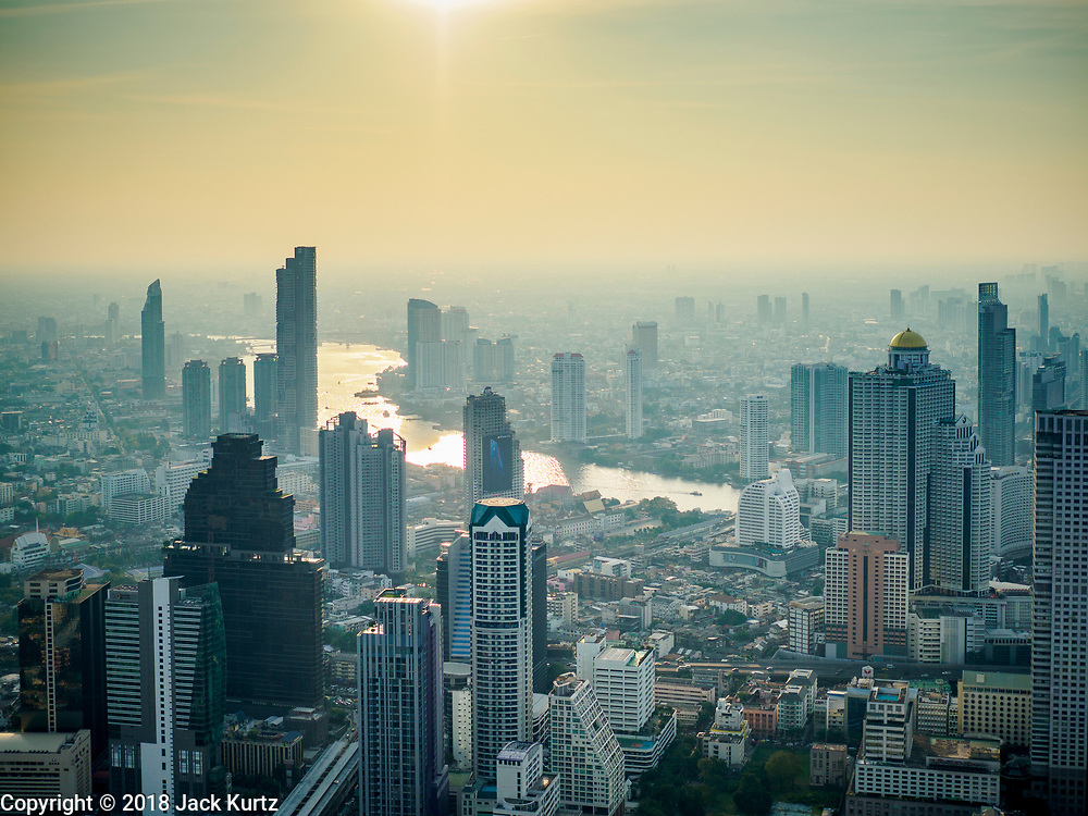 27 DECEMBER 2018 - BANGKOK, THAILAND:  The MahaNakhon Skywalk, at the top of the King Power Maha Nakhon Tower, is  1,030 feet (314 meters) above street level. It is the tallest building and highest vantage point in Bangkok. The skywalk opened in November and has been drawing large crowds.     PHOTO BY JACK KURTZ