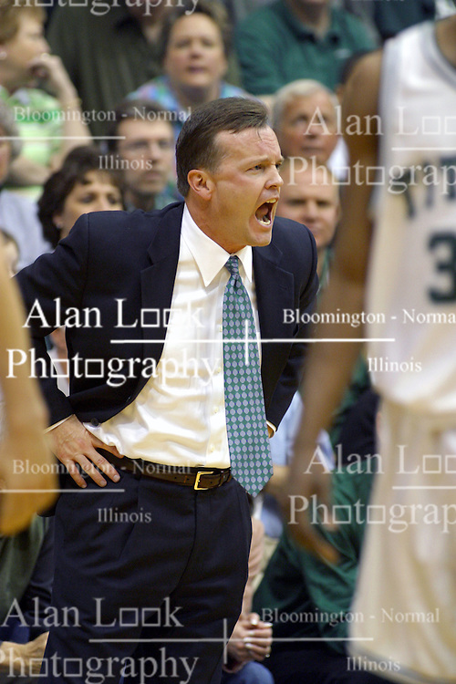 05 March 2005<br /> <br /> Coach Scott Trost.<br /> <br /> Panthers celebrate an 81 - 76 Victory.  The Shirk Center was less than standing room only as 2850 shoe-horned into a 2500 capacity facility.  Hanover was one of only 4 teams to beat the Titans in regular season play. The Titans end the year 21 - 5.  The Panthers continue the trail to Salem with a 24 - 6 record.<br /> <br /> NCAA Division III 2nd Round Regional Playoffs.  Illinois Wesleyan University Titans V Hanover College Panthers.  Shirk Center, Illinois Wesleyan University, Bloomington IL