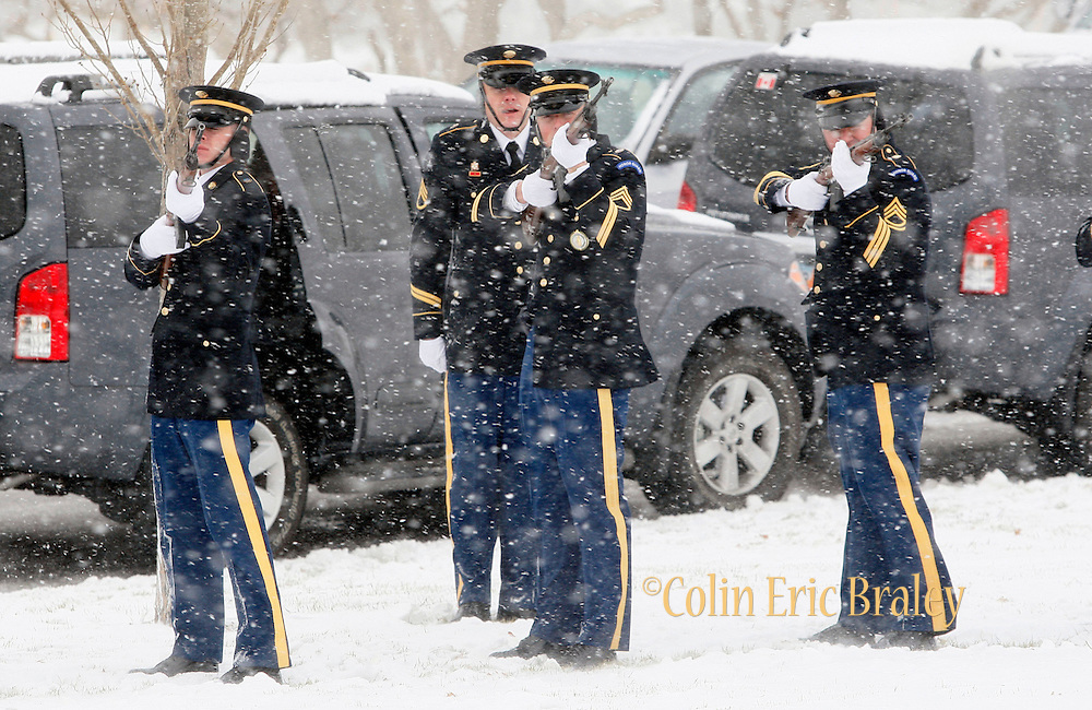 A U.S. Army honor guard fires off a 21-gun salute during the burial ceremony of Pfc. Aaron Nemelka at Camp Williams, Saturday Nov. 14, 2009 in Riverton, Utah. Nemelka was one of 13 gunned down at Fort Hood, Texas. (AP Photo/Colin Braley)