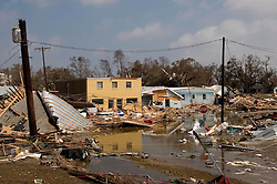 25 Sept, 2005. Cameron, Louisiana. Hurricane Rita aftermath. <br /> The destroyed remains of  downtown business in Cameron, Louisiana two days after the storm ravaged the small town.<br /> Photo; &copy;Charlie Varley/varleypix.com