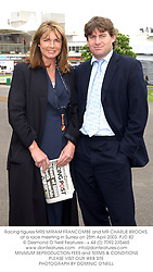 Racing figures MRS MIRIAM FRANCOMBE and MR CHARLIE BROOKS, at a race meeting in Surrey on 25th April 2003.	PJD 82