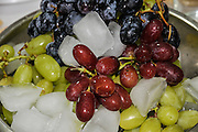 Three varieties of grapes served on ice