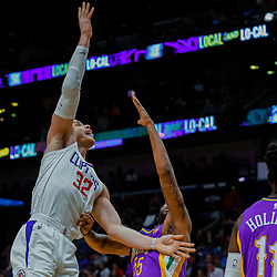 Jan 28, 2018; New Orleans, LA, USA; LA Clippers forward Blake Griffin (32) shoots over New Orleans Pelicans guard E'Twaun Moore (55) during the first quarter at the Smoothie King Center. Mandatory Credit: Derick E. Hingle-USA TODAY Sports
