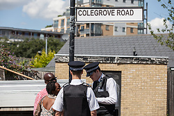 © Licensed to London News Pictures. 06/08/2016. London, UK. Police speak to local residents on Colegrove Road in Peckham where a 16-year-old boy was stabbed to death on the evening of Friday 5 August 2016. Police have launched a murder investigation. Photo credit: Rob Pinney/LNP