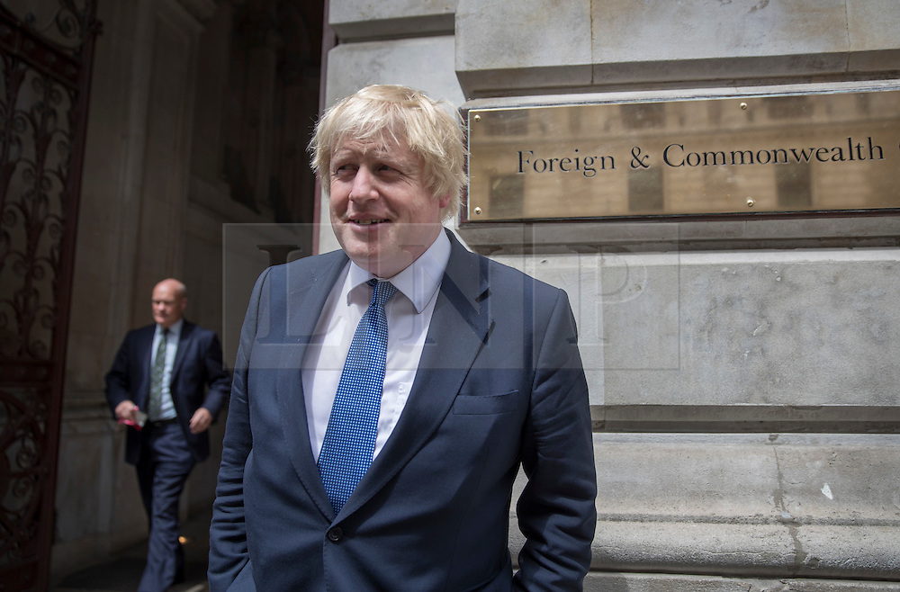 © Licensed to London News Pictures. 14/07/2016. London, UK. Newly appointed Foreign Secretary Boris Johnson stands outside the Foreign Office - as Prime Minister Theresa May continues to make cabinet appointments on her first full day in office. Photo credit: Peter Macdiarmid/LNP