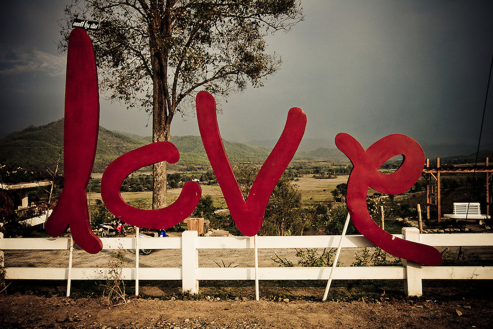 This is the 'Love' portion of a cafe's sign called 'Coffee in Love' just outside of Pai, Thailand, Southeast Asia.