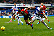 Picture by David Horn/Focus Images Ltd +44 7545 970036<br /> 07/12/2013<br /> Andrew Johnson of Queens Park Rangers (right) and Scott Dann of Blackburn Rovers (left) during the Sky Bet Championship match at the Loftus Road Stadium, London.