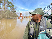 Major Dale Bell and the Mississippi Dept of Wildlife and Fisheries SRT (search and rescue team) cruised down Westbrook Road in Jackson in an airboat Monday ever crest at just below 37ft. Thousands of people have been affected by the flood waters and the water will not recede for days. Photo©SuziAltman