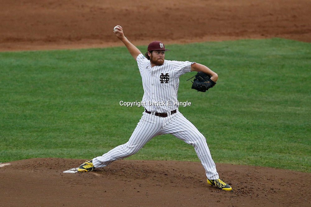 Jun 24, 2013; Omaha, NE, USA; Mississippi State Bulldogs starting pitcher Trevor Fitts (31) delivers a pitch during the second inning in game 1 of the College World Series finals against the UCLA Bruins at TD Ameritrade Park. Mandatory Credit: Derick E. Hingle-USA TODAY Sports