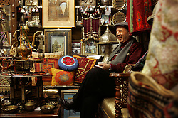 Yasser Barakat, is seen in his shop in the Old City, specializing in antiques and original Palestinian fine art, Jerusalem, Israel, Feb. 12, 2005. Barakat is part of the Palestinian middle and upper class who are likely to have prominent roles in the developing peace process.