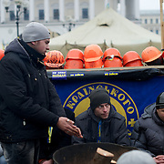 December 19, 2013 - Kiev, Ukraine: Pro-EU demonstrators try to stay warm beside a fire in Independence Square.<br /> On the night of 21 November 2013, a wave of demonstrations and civil unrest began in Ukraine, when spontaneous protests erupted in the capital of Kiev as a response to the government&rsquo;s suspension of the preparations for signing an association and free trade agreement with the European Union. Anti-government protesters occupied Independence Square, also known as Maidan, demanding the resignation of President Viktor Yanukovych and accusing him of refusing the planned trade and political pact with the EU in favor of closer ties with Russia.<br /> After a days of demonstrations, an increasing number of people joined the protests. As a responses to a police crackdown on November 30, half a million people took the square. The protests are ongoing despite a heavy police presence in the city, regular sub-zero temperatures, and snow. (Paulo Nunes dos Santos/Polaris)